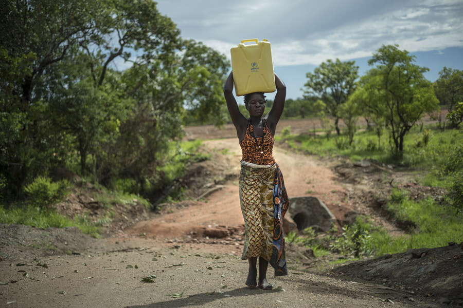 Beatrice carrying some water in Imvepi Refugee Settlement, Uganda. Photo: Kieran Doherty /Oxfam