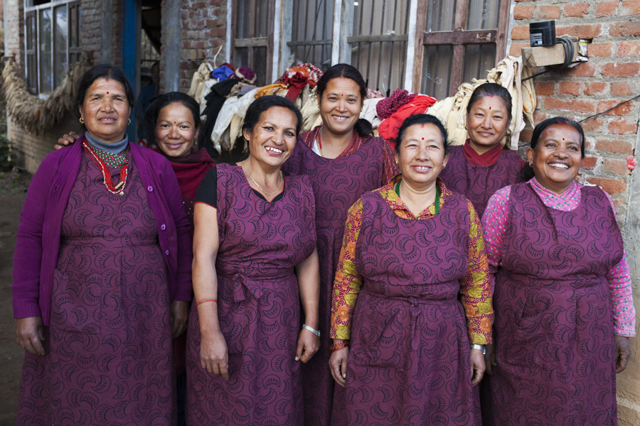 Kathmandu, Nepal: Durga Maharjan (3rd from L), founder and owner of a local weaving business with her employees. Credit: Abbie Trayler-Smith/Oxfam