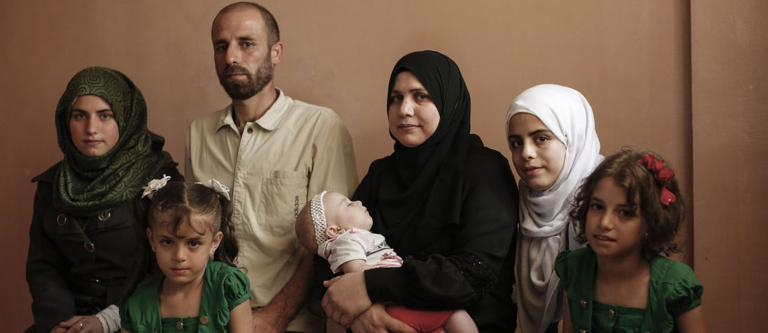 A Syrian refugee family in their home, Zarka, Jordan