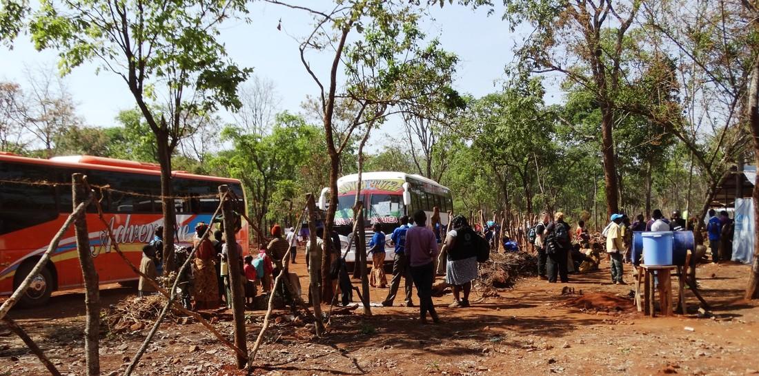 Burundian refugees arrive by bus at Nduta camp, Tanzania