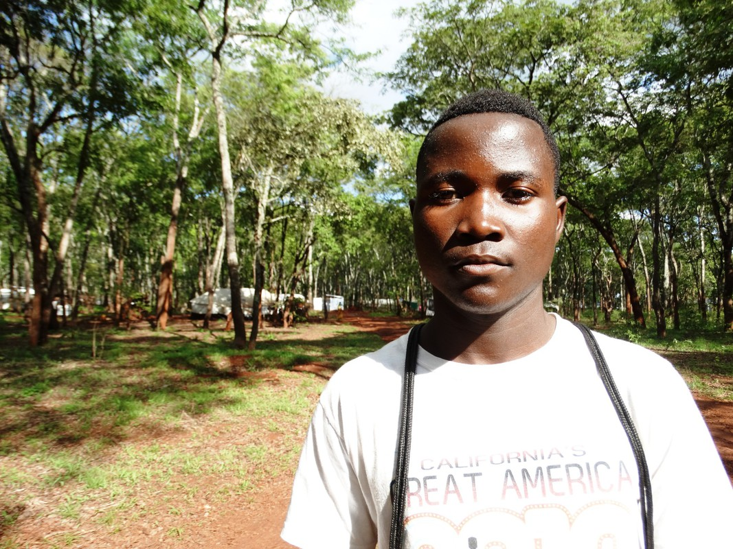 A teenage boy stands in Nduta refugee camp, Tanzania.