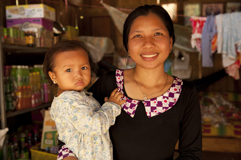 25 year old PlenSoben, pictured with her two-year-old daughter, is a beneficiary of the Saving for Change program. Photo: Panos Pictures/ Patrick Brown