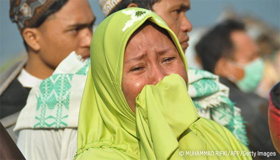 A woman cries after the devastating earthquake and tsunami in Palu, Indonesia. Photo: Muhammad Rifki/AFP/Getty Images