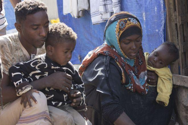 "Jamal Mahyob, 27, lives with his wife Badria, 26, and their two children, in a small tent in a camp in Al-Quba, Yemen. ""Nobody can feel what it means to be a displaced person but those who were forced to leave their houses in search of safety"", he says."