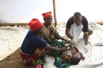 A Burundian refugee is treated in a makeshift clinic at Kakunga Beach, on the border between Burundi and Tanzania on Lake Tanganyika. Photo: James Akena/Oxfam