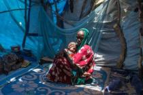 Fatma Abba, 17, from Niger, had to flee her village because of the threat of Boko Haram. She is now living in an IDP camp with her one year old son. Photo: Vincent Tremeau/Oxfam