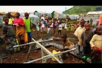 Oxfam delivering water to Belungo camp, Democratic Republic of Congo