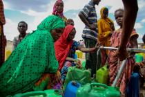 People gather around an Oxfam provided water tank in Hariso, Ethiopia, which provides 10,000 cubic metres of water a day.
