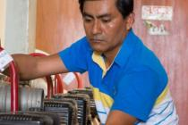 Miguel Siesquen is cleaning water pumps for use in flood emergencies in Illimo, Peru.