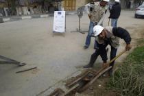 Kamel Qasem clearing storm water drains