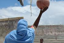 Mulki playing basketball in Mogadishu. Photo: Oxfam