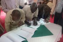 Kiboga leaders signing a final agreement with the New Forests Company in Uganda.