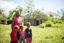 Matarisu village-Sandi and three sons, Wilkins, William and Philip n front of their house damaged by cyclone Pam Photo credit: Groovy Banana/Oxfam AUS