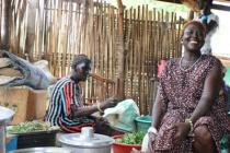 A business woman laughs at work in her restaurant in Rumbek, South Sudan