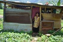 Radhika Majhi, 25, stands in front of her makeshift shelter in Khadgabhanjyang VDC-4 in Nuwakot district. Credit: Roshani Kapali