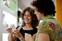 Women shopping in Oxfam shop, Spain
