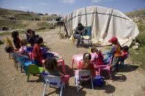 Niños y niñas en clases, en el valle del Jordán. Foto: Simon Rawles/Oxfam
