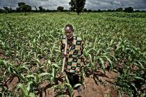 A farmer poses in his field in Burkina Faso