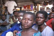 A sister and brother mourn the death of their father, a cocao farmer, in Ivory Coast