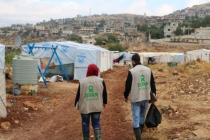Two Oxfam worker walk in Sawere, Bekaa Valley, Lebanon