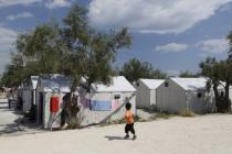 A young child walks through Kara Tepe refugee camp, Greece.