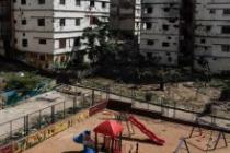 A children's play park sits between the neighbourhoods of Jabal Mohsen and Bab al Tabbaneh in Tripoli. Jabal Mohsen and Bab al Tabbaneh are among the most impoverished and neglected areas in Lebanon. Photo: Sam Tarling/Oxfam