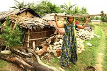 Laxmi Thapa, of Kanchanpur, works in a sand and gravel mine to  make a  small  income. Photo: Oxfam