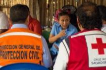 Karen Ramirez (center) meets with members of a national emergency coordination body in a community affected by a storm surge in El Salvador, in 2015.