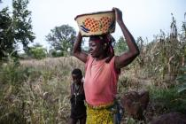 Beatrice, a small scale farmer in Ghana but is forced to make up her income by smashing rocks.