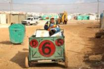 A cash for work volunteer in Za'atari camp delivers materials to Oxfam's recycling centre. Photo: Alix Buck/Oxfam