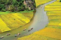 A river in North Vietnam, across fields during harvest season. Photo: Cong Hung/Oxfam