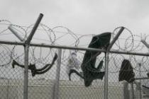 Barbed wire fences surrounding the refugee reception facilities on the islands. Credit: Matthew Cassel
