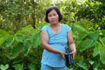Through a local energy plan, Mai Thi Chau is helping her commune in Vietnam's Ca Mau province switch to renewable energy systems and biogas cooking, to save time and money. Photo: Tessa Bunney/Oxfam