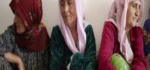 Women sit together in Tajikistan