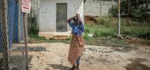 Woman in an Ebola quarantine zone, in Sierra Leone. Photo: Pablo Tosco/Oxfam