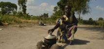 A woman cooking outside her home in South Sudan