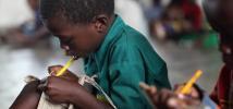 Eric Gavinara, 7, practising his writing at school. Grade 2, Bvumbwe Primary School. Thyolo. Southern Malawi.