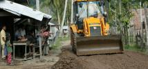 Sapek village where the road is being rebuilt and an Oxfam funded JCB does the work. Lamno, Aceh Province, Sumatra, Indonesia