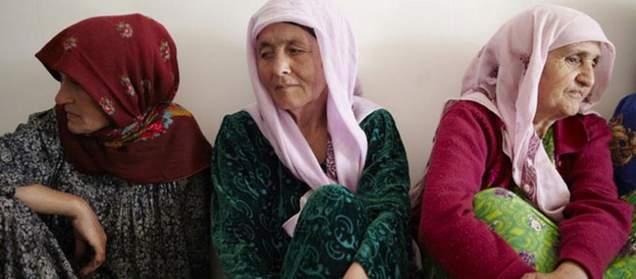 Women sit together in Tajikistan