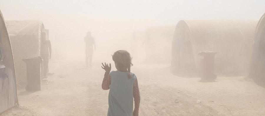 A dust storm in Al Tinah camp, Iraq. In September 2016, Oxfam and local partners distributed water and sanitation materials to displaced families living in this small camp of 200 tents and to hosting communities. Photo: Amy Christian/Oxfam