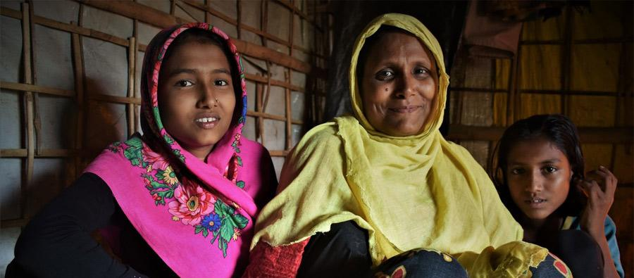 Rohingya refugee Ayesha with her daughters in her shelter in the camps in Cox's Bazar, Bangladesh. Credit: Maruf Hasan/Oxfam