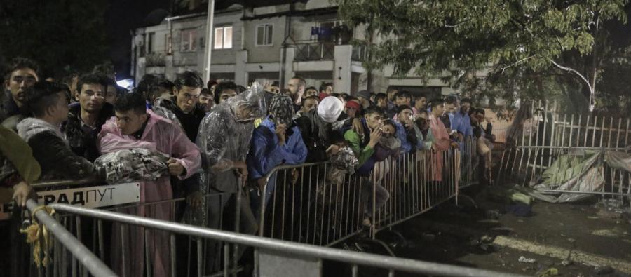 Refugees wait to register for a travel permit in Serbia. Photo: Simon Tarling/Oxfam