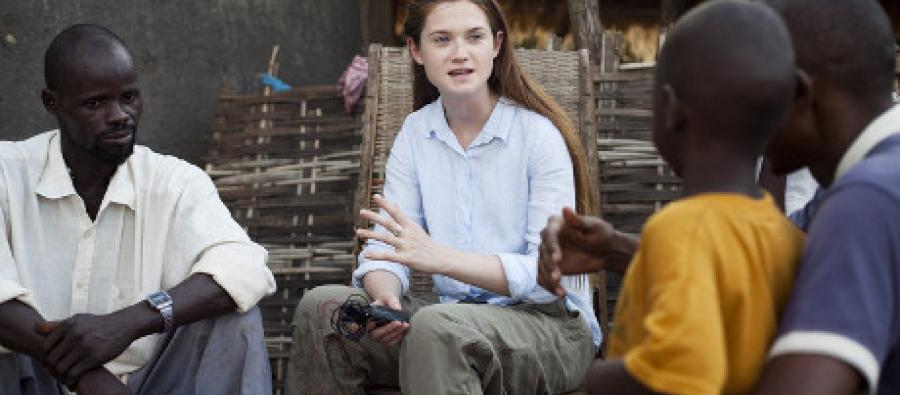 Bonnie Wright chats with Aissatou and 2 of his sons. Photo: Harry Borden/Oxfam