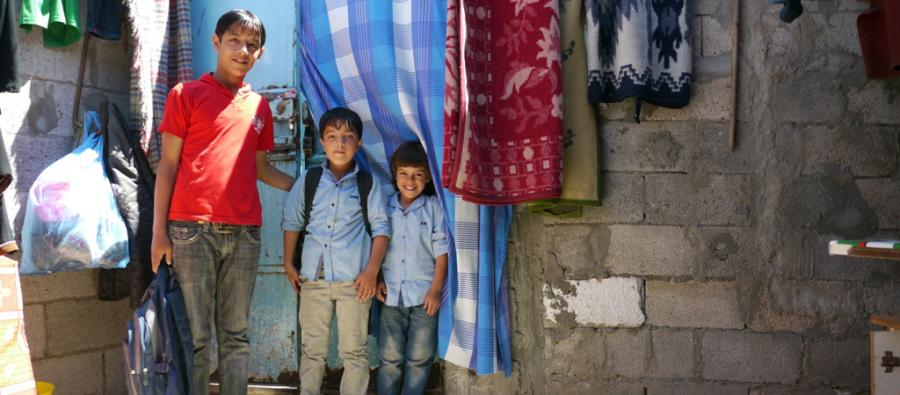 Three of Abeer Al-Sawi's children stand outside their home in Gaza