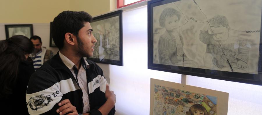 17 year old Hamza Shaheen and his family had to flee their home to escape the bombing. At CFTA  he was encouraged to paint about what he went through. Photo: Oxfam