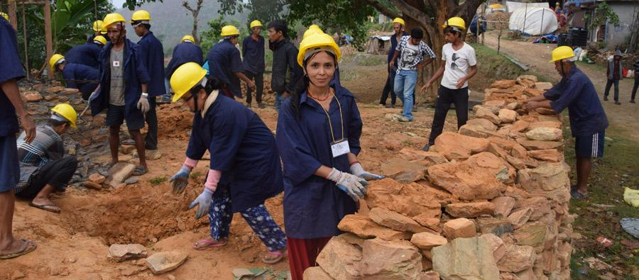 Rita Thapa and others clearing a site before starting the mason training. Photo: Bipana Dhimal/Oxfam