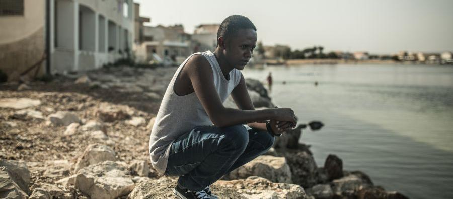 Like Jamal, 23, from Somalia, thousands of refugees and migrants face kidnap, slavery, torture or sexual violence in Libya before crossing the Mediterranean. Photo: Pablo Tosco/Oxfam