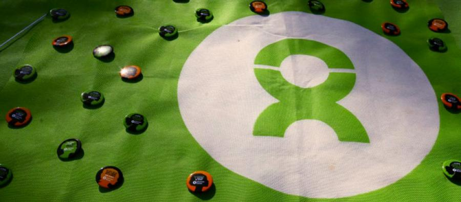 Flag and pins with Oxfam logo