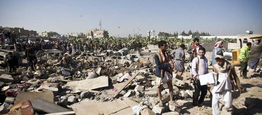 Locals search for survivors in the rubble following Saudi air strikes, near Sana'a Airport, Yemen. Photo: Abo Haitham