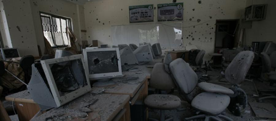 Computers destroyed by tank shells, in Gaza's University College of Applied Sciences (UCAS)